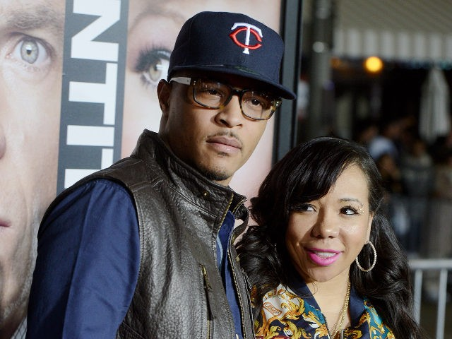 """LOS ANGELES, CA - FEBRUARY 04: Actor/rapper T.I. (L) and his wife Tiny arrive at the premiere of Universal Pictures' """"Identity Thief"""" at the Village Theatre on February 4, 2013 in Los Angeles, California. (Photo by Kevin Winter/Getty Images)"""