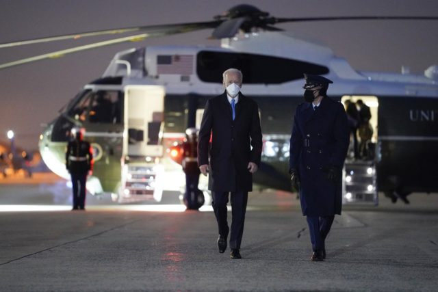President Joe Biden walks to board Air Force One for a trip to Camp David Friday Feb. 12 2021 in Andrews Air Force Base Md