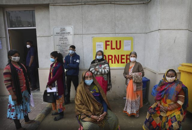 People wait outside a health center to get tested for COVID-19 in New Delhi, India, Thursday, Feb. 11, 2021. When the coronavirus pandemic took hold in India, there were fears it would sink the fragile health system of the world's second-most populous country. Infections climbed dramatically for months and at …