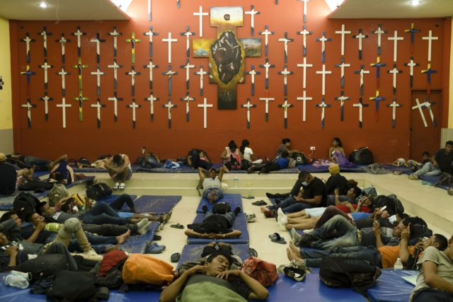 """Central American migrants rest at """"The 72"""" shelter in Tenosique, Tabasco state, Mexico, Tuesday, Feb. 9, 2021. Only six weeks into the year, the shelter has hosted nearly 1,500 migrants compared to 3,000 all of last year, even though it has halved its dormitory capacity due to the new cornavirus …"""