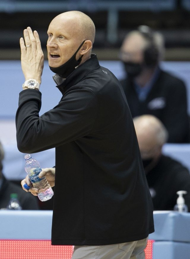 Louisville head coach Chris Mack directs his players on defense against North Carolina during the first half of an NCAA college basketball game, Saturday, Feb. 20, 2021, at the Smith Center in Chapel Hill, N.C. (Robert Willett/The News & Observer via AP)