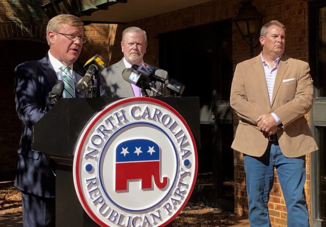 North Carolina House Speaker Tim Moore, left, R-Cleveland, speaks to reporters, with Senate leader Phil Berger, R-Rockingham, and House Majority Leader John Bell, right, R-Wayne, at a news conference on Wednesday, Nov. 4, 2020 at state GOP headquarters in Raleigh, N.C., to discuss Election Day results. North Carolina Democrats were …