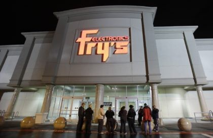 In this Oct. 21, 2009 file photo, a small crowd begins to gather outside a Fry's Electronics store in Renton, Wash. The electronics chain is permanently closing, citing the struggles it faced as a retailer during the coronavirus pandemic. The company, which was in business for 36 years, had 31 …