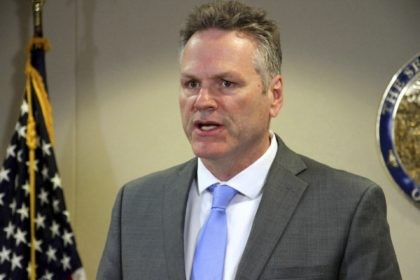In this March 9, 2020, file photo, Alaska Gov. Mike Dunleavy addresses reporters at a news conference in Anchorage, Alaska. Dunleavy has mild symptoms of COVID-19 and a state House member also tested positive Wednesday, officials said. Alaska House Speaker Louise Stutes asked members and staff not to enter the …