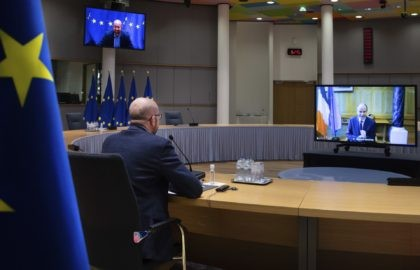European Council President Charles Michel speaks with Ireland's Prime Minister Micheal Martin, on screen right, via videoconference at the European Council building in Brussels, Wednesday, Feb. 24, 2021. (AP Photo/Olivier Matthys, Pool)