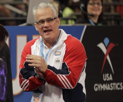 In this March 3, 2012, file photo, gymnastics coach John Geddert is seen at the American Cup gymnastics meet at Madison Square Garden in New York. Prosecutors in Michigan filed charges Thursday, Feb. 25, 2021, against Geddert, a former U.S. Olympics gymnastics coach with ties to disgraced sports doctor Larry …