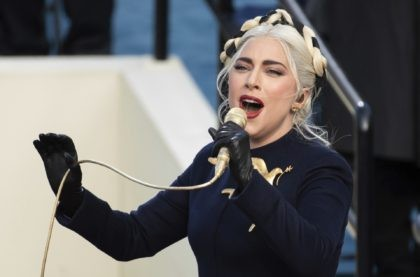 Lady Gaga sings the national anthem during President-elect Joe Biden's inauguration at the U.S. Capitol in Washington on Jan. 20, 2021. Officials say Lady Gaga's dog walker was shot and her two French bulldogs stolen in Hollywood during an armed robbery. Los Angeles police are seeking two suspects, thought it's …