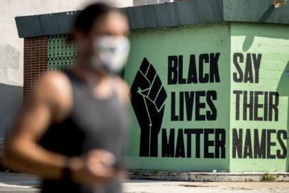 In this July 13, 2020, file photo, a black lives matter mural is visible in the Shaw neighborhood in Washington. The Black Lives Matter Global Network Foundation, which grew out of the creation of the Black Lives Matter movement, is formally expanding a $3 million financial relief fund that it …