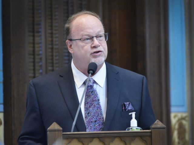 Sen. Jim Runestad, R-White Lake, speaks from the Senate floor Thursday in support of Senate Joint Resolution G, his measure that would protect residents against certain unreasonable searches and seizures. The Senate unanimously approved SJRG.