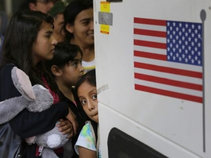 FILE - In this July 7, 2015 file photo, immigrants from El Salvador and Guatemala who entered the country illegally board a bus after they were released from a family detention center in San Antonio. Attorneys on Friday, Aug. 30, 2019, asked a judge to reject Trump administration plans to …