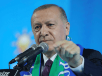 Turkish President Recep Tayyip Erdogan addresses his ruling party's supporters in the Black Sea city of Rize, Turkey, Monday, Feb. 15, 2021. Erdogan laid into the United States, accusing it of supporting Kurdish militants on Monday, days after Turkish troops found the bodies of 13 Turkish soldiers, police and civilians …