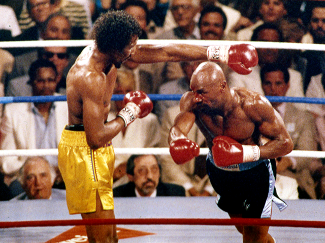 """In this April 1985 file photo, Marvin Hagler, right, and Thomas Hearns fight during the first round of a world championship boxing bout in Las Vegas. Hagler, the middleweight boxing great whose title reign and career ended with a split-decision loss to """"Sugar"""" Ray Leonard in 1987, died Saturday, March …"""