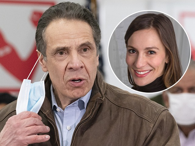 (INSET: Alessandra Biaggi) New York Gov. Andrew Cuomo removes his mask during a visit to a COVID-19 vaccination site, Monday, March 15, 2021, at the State University of New York in Old Westbury. The site is scheduled to open on Friday. (AP Photo/Mark Lennihan, Pool)