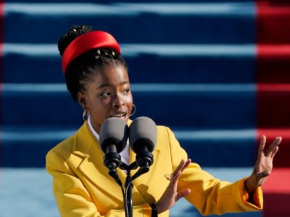 WASHINGTON, DC - JANUARY 20: American poet Amanda Gorman reads a poem during the the 59th inaugural ceremony on the West Front of the U.S. Capitol on January 20, 2021 in Washington, DC. During today's inauguration ceremony Joe Biden becomes the 46th president of the United States. (Photo by Patrick …