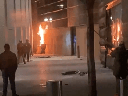 Antifa rioters set boarded-up windows on fire outside the Hatfield Federal Courthouse in Portland, Oregon, on March 11, 2021. (Twitter Screenshot/Jennifer Dowling-KOIN6)