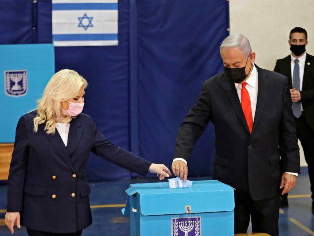 Benjamin Netanyahu votes (Ronen Zvulun / AFP / Getty)