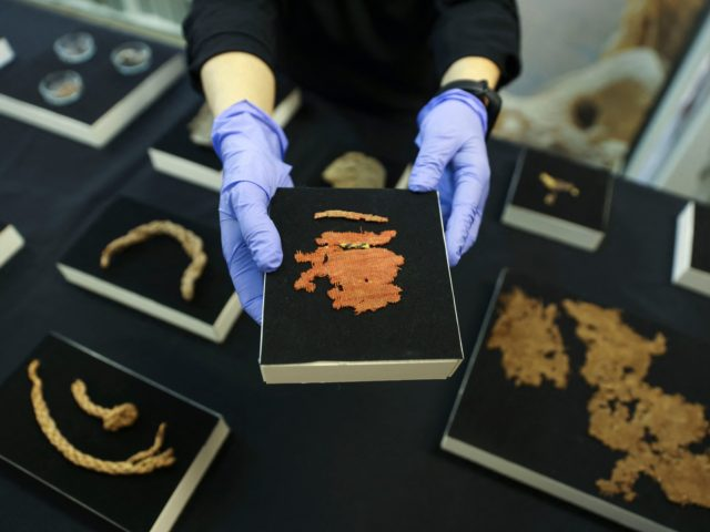 An archaeologist at the Israel Antiquities Authority (IAA) shows a cloth fragment from the Bar Kochba Jewish revolt period dating back to 132136 CE, excavated from an area in the Judean Desert, after conservation work is done at the IAA's Dead Sea conservation laboratory in Jerusalem, on March 16, 2021. …