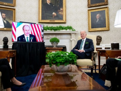 WASHINGTON, DC - MARCH 17: U.S. President Joe Biden speaks during a virtual meeting with Irish Prime Minister (Taoiseach) Micheal Martin in the Oval Office of the White House on March 17, 2021 in Washington, DC. Two of Biden's great-great-grandparents emigrated from Ireland. (Photo by Erin Scott-Pool/Getty Images)