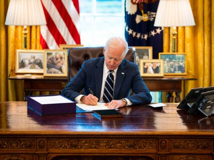 WASHINGTON, DC - MARCH 11: U.S. President Joe Biden participates in a bill signing in the Oval Office of the White House on March 11, 2021 in Washington, DC. President Biden has signed the $1.9 trillion COVID relief bill into law at the event. (Photo by Doug Mills-Pool/Getty Images)
