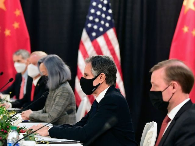 The US delegation led by Secretary of State Antony Blinken (C), flanked by US National Security Advisor Jake Sullivan (R), face their Chinese counterparts at the opening session of US-China talks at the Captain Cook Hotel in Anchorage, Alaska on March 18, 2021. (Photo by Frederic J. Brown/AFP via Getty …