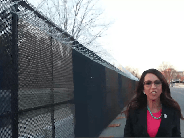 Congresswoman Lauren Boebert (R-CO) walks in front of the Capitol fence. (Congresswoman Lauren Boebert/Youtube)
