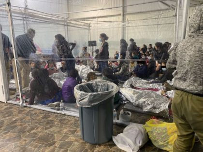 This photo released to Axios by Rep. Henry Cuellar (D-TX) shows a crowded Border Patrol holding pen in Donna, Texas.