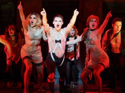 In this file photo provided by Joan Marcus, Randy Harrison as the Emcee and the 2016 National Touring cast of Roundabout Theatre Company's CABARET. (Joan Marcus via Getty Images)