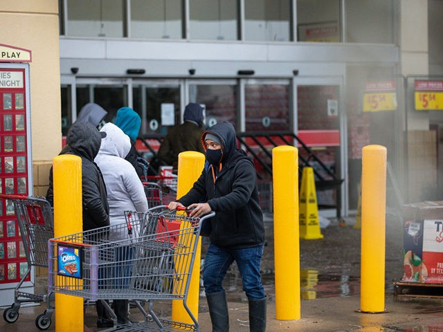 AUSTIN, TX - FEBRUARY 17, 2021: People wait in long lines at an H-E-B grocery store in Austin, Texas on February 17, 2021. Millions of Texans are still without water and electric as winter storms continue. (Photo by Montinique Monroe/Getty Images)