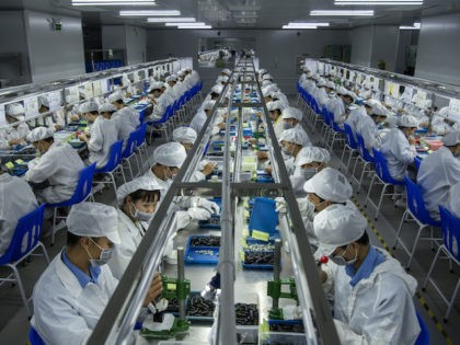 Workers make pods for e-cigarettes on the production line at Kanger Tech, one of China's leading manufacturers of vaping products, on September 24, 2019 in Shenzhen, China. (Kevin Frayer/Getty Images)