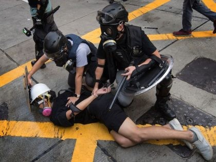 Police arrest a protester in the Wanchai area of Hong Kong on October 1, 2019, as the city observes the National Day holiday to mark the 70th anniversary of communist China's founding. (Mark Ralston/AFP via Getty Images)