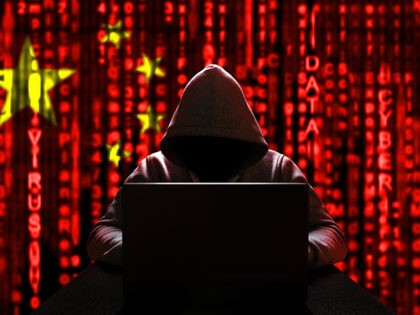 Cyber threat from china. Chinese hacker at the computer, on a background of binary code, the colors of the Chinese flag. DDoS attack