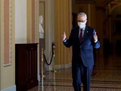 Senate Majority Leader Chuck Schumer of N.Y., gives a thumbs up after he Senate passed a COVID-19 relief bill in Washington, Saturday, March 6, 2021. (AP Photo/J. Scott Applewhite)