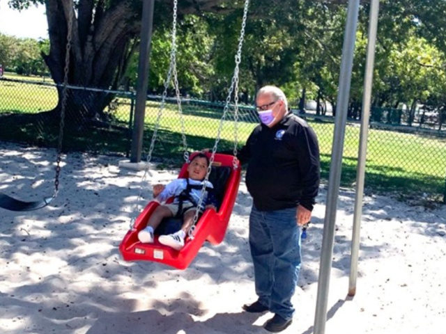 Community Installs Park Swing for Special Needs Boy