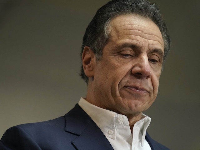 New York Governor Andrew Cuomo speaks before receiving a Covid-19 vaccine, at a church in the Harlem section of New York, on March 17, 2021. (Seth Wenig/AFP via Getty Images)