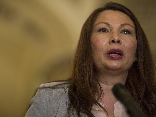 Sen. Tammy Duckworth (D-IL) speaks during a weekly news conference on Capitol Hill on August 21, 2018 in Washington, DC. (Zach Gibson/Getty Images)