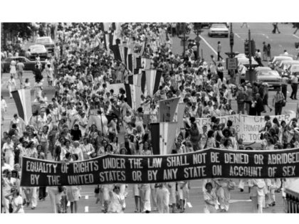 Supporters of the Equal Rights Amendment carry a banner down Pennsylvania Avenue in Washington D.C. on Friday, August 26, 1977. The march followed a ceremony in the White House Rose Garden during which U.S. President Carter signed a Women's Equality Day proclamation. (AP Photo)