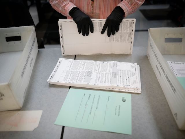 In this file photo, an electoral worker organizes vote-by-mail ballots at the Miami-Dade County Election Department in Miami, Florida on October 19, 2020. (Eva Marie Uzcategui/AFP via Getty Images)
