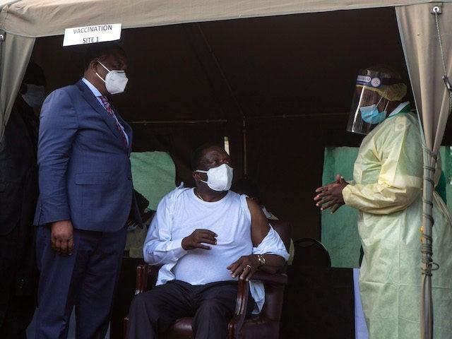 A nurse explains details of the Sinopharm vaccine to Zimbabwe's president Emmerson Mnangagwa before vaccination on March 24, 2021 in Victoria Falls, Zimbabwe. (Tafadzwa Ufumeli/Getty Images)