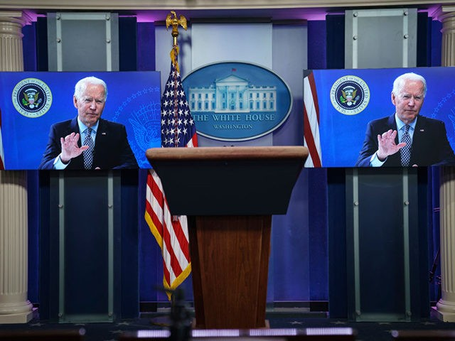 WASHINGTON, DC - FEBRUARY 25: U.S. President Joe Biden is displayed on screens in the White House press briefing room as he addresses the National Governors Association on February 25, 2021 in Washington, DC. (Photo by Drew Angerer/Getty Images)