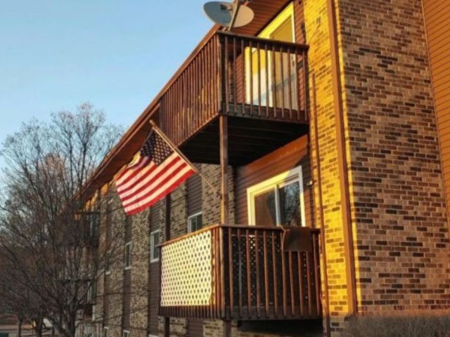 A Fargo, North Dakota, man said he's been receiving threatening letters from his condo association over complaints that his American flag is making too much noise on windy days. (Andrew Almer)