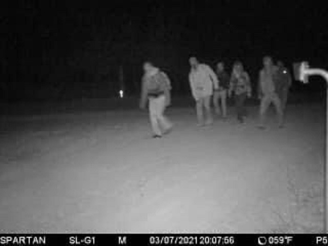 A rancher's game-cam captures a group of migrants marching through his ranch to avoid a Border Patrol checkpoint. (Photo: Kinney County Sheriff's Office)