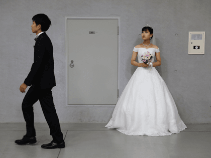 A bride waiting in the queue during an wedding ceremony of the Family Federation for World Peace and Unification, commonly known as the Unification Church, at Cheongshim Peace World Center on August 27, 2018 in Gapyeong-gun, South Korea. Some 4,000 'Moonies', believers of Unification Church, which was named after the …