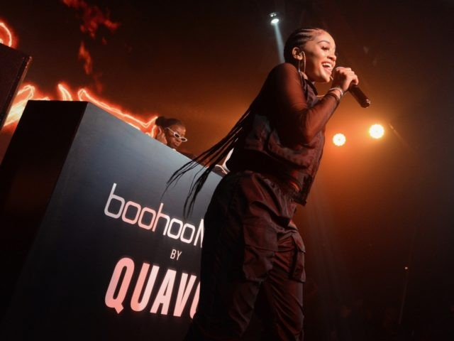 LOS ANGELES, CALIFORNIA - APRIL 10: Saweetie performs onstage at the boohooMAN x Quavo Launch Party at The Sunset Room on April 10, 2019 in Los Angeles, California. (Photo by Vivien Killilea/Getty Images for boohooMAN)