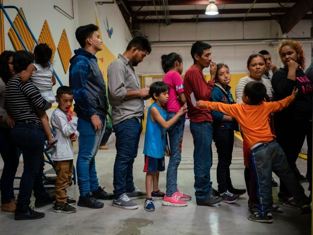 Migrant children from different Latin American wait to receive food at the Casa del Refugiado, or The House of Refugee, a new centre opened by the Annunciation House to help the large flow of migrants being released by the United States Border Patrol and Immigration and Customs Enforcement in El …