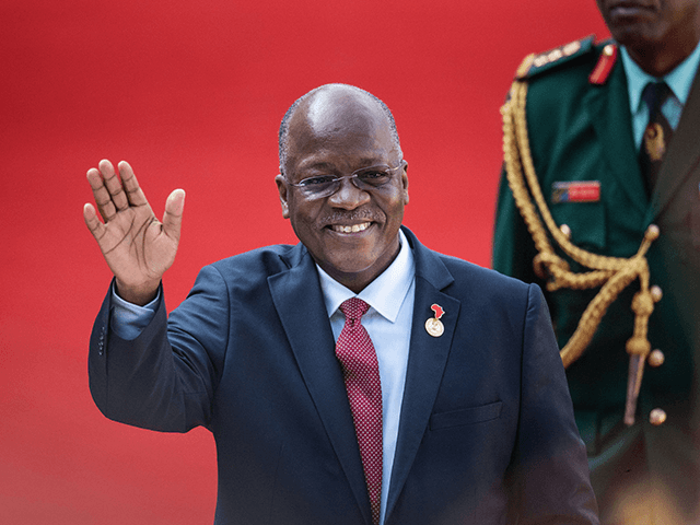 Tanzanian President John Pombe Magufuli gestures while arriving at the Loftus Versfeld Stadium in Pretoria, South Africa, for the inauguration of Incumbent South African President Cyril Ramaphosa on May 25, 2019. (Photo by Michele Spatari / AFP) (Photo credit should read MICHELE SPATARI/AFP via Getty Images)
