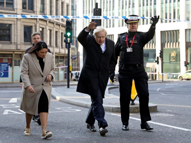 LONDON, ENGLAND - NOVEMBER 30: British Prime Minister Boris Johnson, Home Secretary Priti Patel, (L) and City of London commissioner Ian Dyson (R) visit the scene of yesterday's London Bridge stabbing attack on November 30, 2019 in London, England. A man and a woman were killed and three seriously injured …