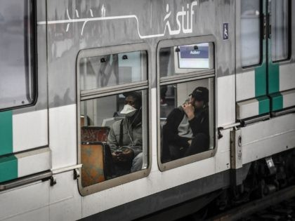 A commuter wearing a protective facemask sits in the carriage of a RER suburban train in Paris on April 9, 2020, on the twenty-fourth day of a lockdown in France to attempt to halt the spread of the novel coronavirus COVID-19. (Photo by STEPHANE DE SAKUTIN / AFP) (Photo by …
