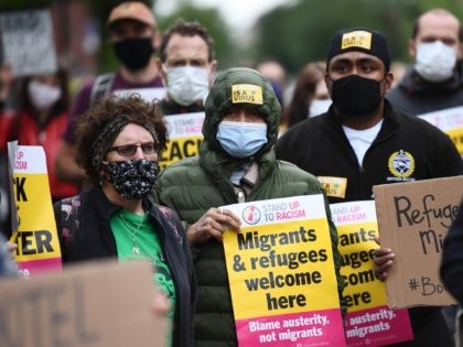 GLASGOW, SCOTLAND - JULY 01: Demonstrators join a 'Refugees Lives Matter' protest on July 1, 2020 in Glasgow, Scotland. The anti-racism demonstration called for an end to the detention of asylum seekers in hotels after six people were injured in a knife attack at Park Inn Hotel in Glasgow last …