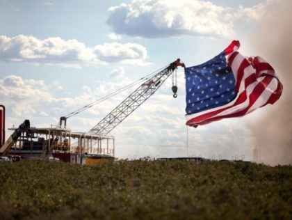 MIDLAND, TX - JULY 28: The American flag is raised at the site of a Double Eagle Energy rig on July 28, 2020 in Midland, Texas. President Donald Trump is making his 16th visit to the state, where he will tour a rig owned by Double Eagle Energy and deliver …