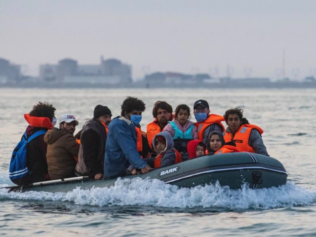 Waleed (C), 29, a Kuwaiti migrant, sits in a dinghy with his brother's family and other migrants as they illegally cross the English Channel from France to Britain on September 11, 2020. - The number of migrants crossing the English Channel -- which is 33,8 km (21 miles) at the …